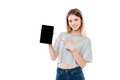 Smiling attractive girl pointing finger at black screen tablet computer Royalty Free Stock Photo