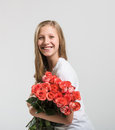 Smiling attractive girl with roses bouquet on white background Royalty Free Stock Images