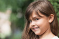Smiling attractive little girl peeks at the camera Royalty Free Stock Photo