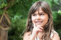Smiling attractive little girl peeks up Royalty Free Stock Photo