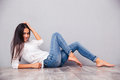 Smiling attractive woman lying on the floor Royalty Free Stock Photo