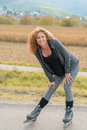 Smiling attractive young woman on roller blades Royalty Free Stock Photo