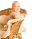 Smiling baby in armchair Stock Photos