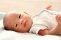 Smiling baby boy a on a bed Royalty Free Stock Images