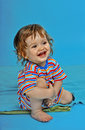 Smiling baby boy with blue background Royalty Free Stock Photo