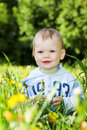 Smiling baby boy play with dandelions Royalty Free Stock Photo