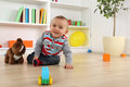 Smiling baby child playing with toys Royalty Free Stock Photo