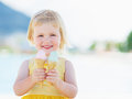 Smiling baby eating two ice cream horns Royalty Free Stock Photo