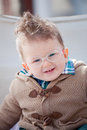 Smiling baby with eyeglasses and funny hair Stock Image
