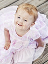 Smiling baby face of girl in a pink dress Royalty Free Stock Image