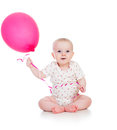 Smiling baby girl with red balloon ballon in her hand on white Stock Photo