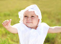 Smiling baby girl showing finger up Royalty Free Stock Images