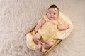Smiling Baby Girl Wearing a Yellow Romper Royalty Free Stock Photo