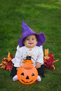 Smiling baby halloween witch Stock Images