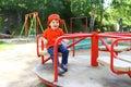 Smiling baby on merry-go-round