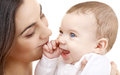 Smiling baby in mother hands picture of happy with over white Stock Photo