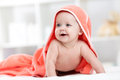 Smiling baby after shower or bath with towel on head Royalty Free Stock Photo