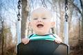 Smiling Baby Swinging Royalty Free Stock Photo
