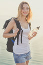 Smiling backpacker girl is holding water bottle Royalty Free Stock Photo