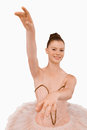 Smiling ballerina with her arms extended Royalty Free Stock Image