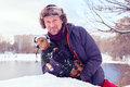 Smiling bearded man and small dog in funny winter hats Royalty Free Stock Photo