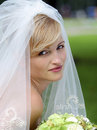 Smiling beautiful bride in white Royalty Free Stock Photography