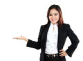 Smiling beautiful business woman presenting blank area Royalty Free Stock Photo