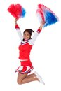 Smiling beautiful cheerleader with pompoms Stock Images