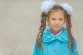 Smiling beautiful girl with bows in blue cloak little Stock Photo
