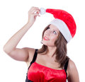 Smiling beautiful girl with santa hat touching cheek face her hand isolated on white background this image has attached Stock Images