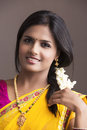 Smiling beautiful indian girl in traditional indian half sari looking at the camera Stock Photo