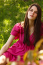 Smiling beautiful teen girl relax outdoor on spring green grass Royalty Free Stock Photo