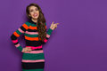 Smiling Beautiful Woman In Colorful Striped Dress Pointing Royalty Free Stock Photo