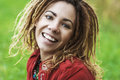 Smiling beautiful woman with dreadlocks young in red clothes closeup Royalty Free Stock Images