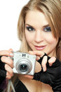 Smiling beautiful woman holding a photo camera Royalty Free Stock Images