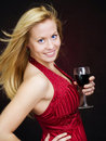 Smiling beautiful woman holding wine and celebrati Stock Photos