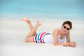Smiling beautiful woman lie on the beach lie on the beach Royalty Free Stock Photo
