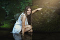 Smiling beautiful woman posing in a stream Royalty Free Stock Photo