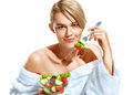 Smiling beautiful woman with salad at morning breakfast
