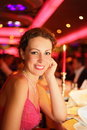 Smiling beautiful woman wearing evening dress Stock Photos