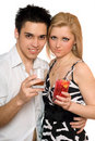 Smiling beautiful young couple with cocktails Stock Images