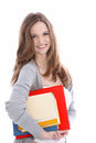 Smiling beautiful young student with books teenage female her for class tucked under her arm isolated on white Royalty Free Stock Image
