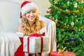 Smiling beautiful young woman giving a gift Royalty Free Stock Photography