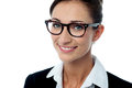 Smiling bespectacled corporate woman cheerful female business executive face closeup Stock Images