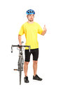 Smiling bicyclist posing and giving thumb up Stock Photos