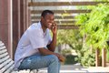 Smiling black guy talking on mobile phone outside Royalty Free Stock Photo