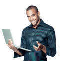 Smiling black man with laptop Royalty Free Stock Photo