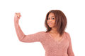 Smiling black woman flexes her bicep over white background isolated Royalty Free Stock Photo