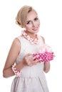 Happy beautiful woman holding small gift box with ribbon. Elegant lady