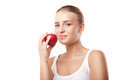 Smiling blond woman eating red apple on white background Royalty Free Stock Image